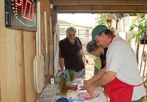 Albert Grande making pizza